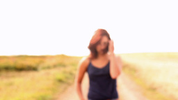 Gorgeous Content Brunette Walking To Camera stock footage