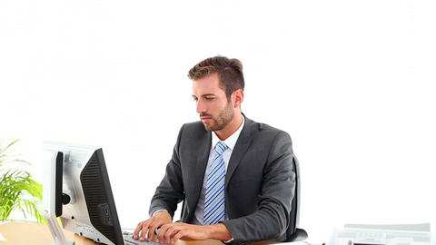 Businessman working at his desk and winning someth Footage