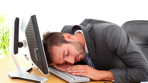 Exhausted businessman sleeping at his desk Footage