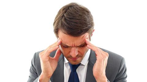 Businessman getting a headache Footage