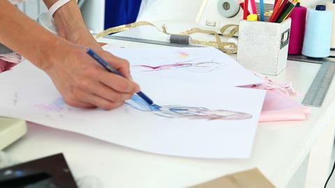 Fashion designer sketching a dress design Footage