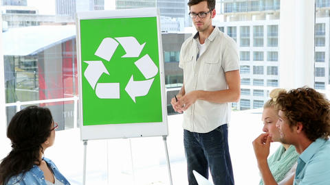 Man present environmental awareness plan to coworkers Footage