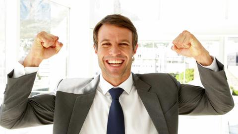 Happy businessman cheering Footage