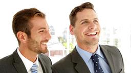 Smiling businessmen talking together Footage