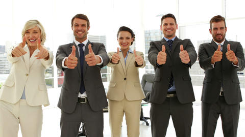 Business people giving thumbs up standing in a row Footage