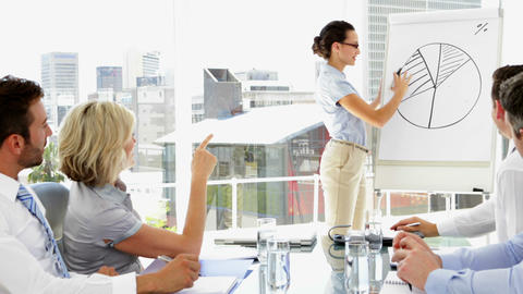 Businesswoman giving presentation to co workers Footage