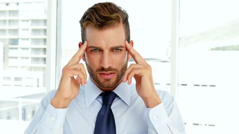 Businessman having a migraine Footage