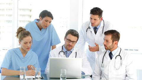 Doctor speaking with his staff during a meeting Footage