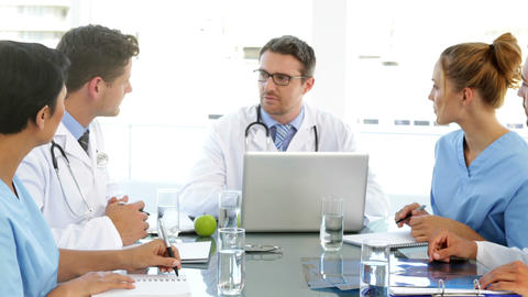 Doctor talking with his staff during a meeting Footage