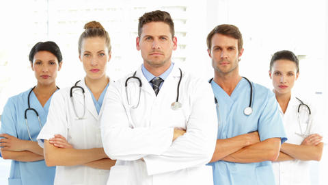 Serious medical team with arms crossed Footage