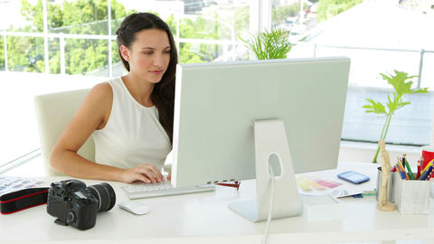 Attractive businesswoman working concentrated at her desk Footage