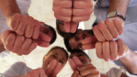 Businesspeople showing thumbs up at camera Stock Video Footage