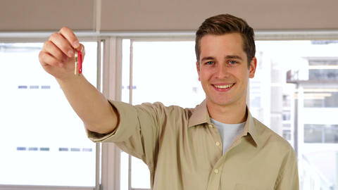 Handsome businessman showing his keys Stock Video Footage