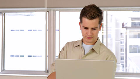 Concentrated businessman working on his laptop Stock Video Footage
