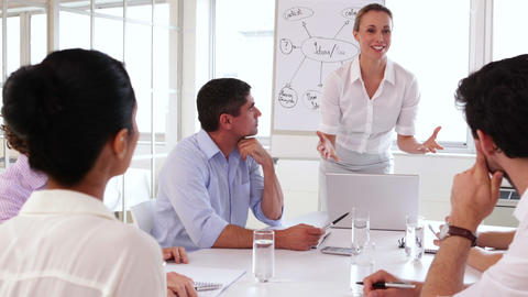 Cheerful businesswoman talking to business team Stock Video Footage