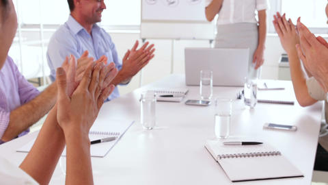 Business team applauding after a presentation Filmmaterial