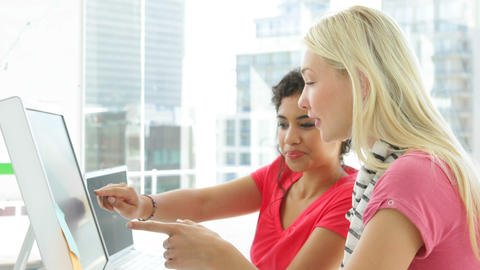 Attractive creative designer talking to her colleague Stock Video Footage