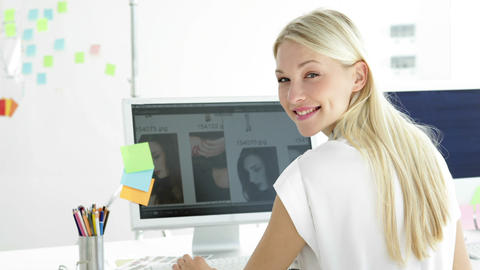 Rear view of attractive creative designer working on her... Stock Video Footage