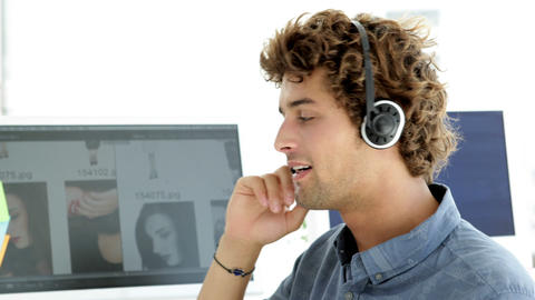 Content creative designer phoning with headset Stock Video Footage