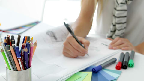 Focused young creative designer sketching ideas Stock Video Footage