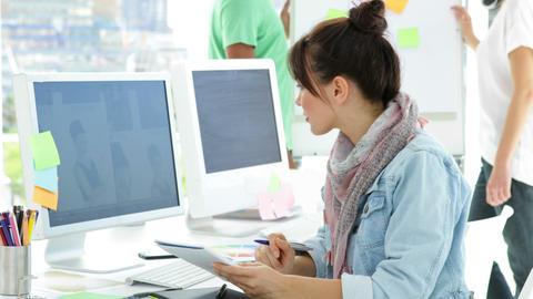 Cute creative designer working sitting at her desk Footage