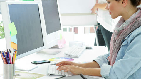 concentrated creative manager working at her desk Stock Video Footage