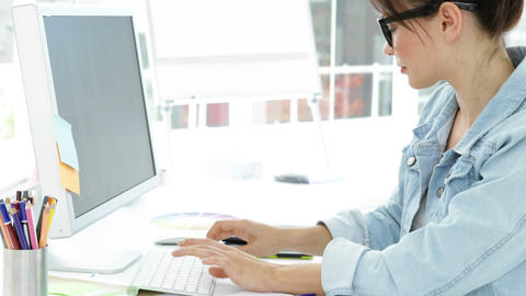 Attractive creative designer working sitting at her desk Footage