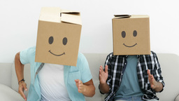 Silly employees with boxes on their heads doing the robot Stock Video Footage