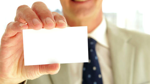 Businessman showing his card to camera Stock Video Footage