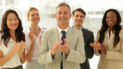 Business team smiling at camera and clapping Stock Video Footage