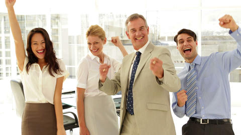 Business team smiling at camera and cheering Stock Video Footage