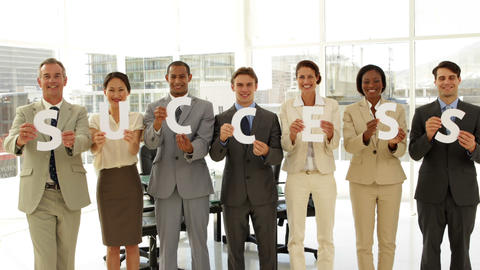 Business people holding letters spelling success Footage