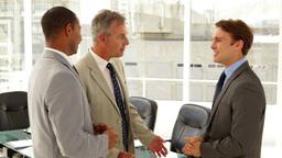 Businessmen talking together Footage