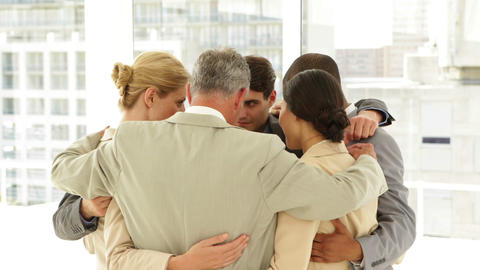 Business people hugging each other in a circle Stock Video Footage