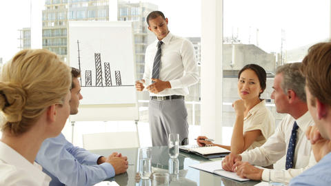Businessman explaining bar chart to colleagues at... Stock Video Footage