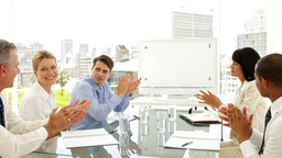 Business people applauding at a meeting Stock Video Footage
