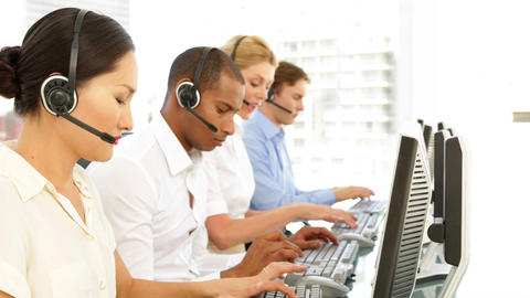 Call centre employees at work Stock Video Footage