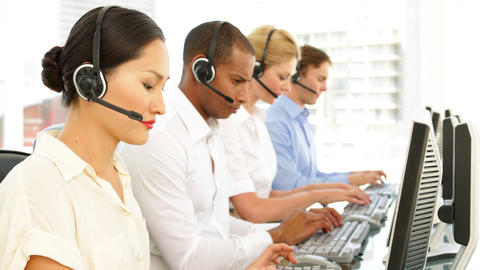 Call centre employees working Stock Video Footage