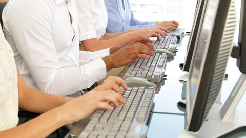 Business people typing in a row Stock Video Footage