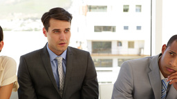 Business people waiting for an interview in a line Stock Video Footage
