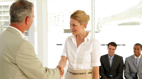 Businessman shaking the hand of job applicant and talking... Stock Video Footage