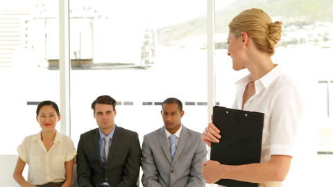 Businesswoman giving thumbs to camera in front of applicants Stock Video Footage