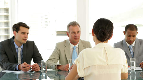Businesswoman being interviewed by panel Stock Video Footage