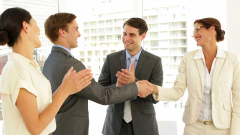 Business people shaking hands at interview while others... Stock Video Footage