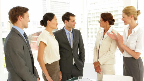 Business people shaking hands at interview while others clap Stock Video Footage