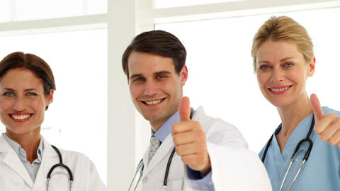 Medical team giving thumbs up to camera Stock Video Footage