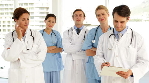 Medical team looking at camera and each other Stock Video Footage
