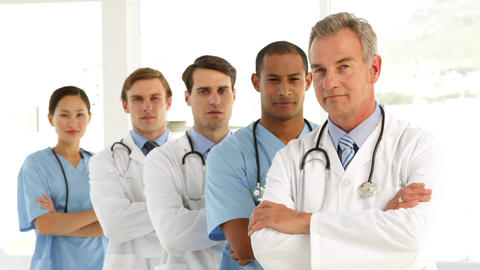 Medical team crossing arms and looking at each other Stock Video Footage