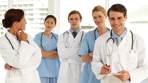 Medical team looking at camera Footage