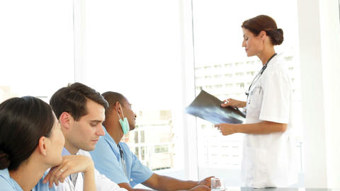 Medical team talking during a meeting looking at xray Stock Video Footage